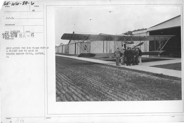 Airplanes - Inspection - Inspecting the new plane before a flight can be made at Wilbur Wright Field, Dayton, O. C.P.I