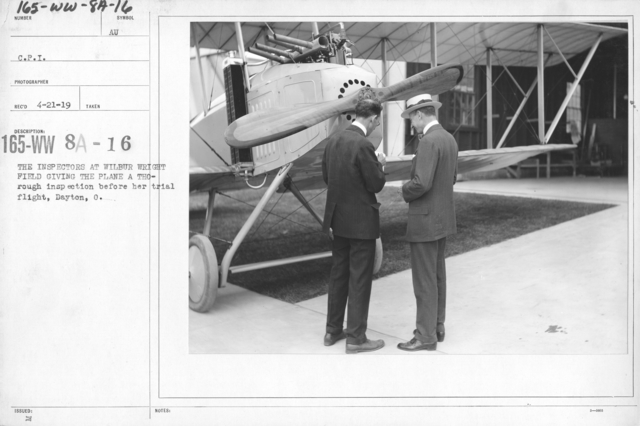 Airplanes - Inspection - The inspectors at Wilbur Wright Field giving the plane a thorough inspection before her trial flight, Dayton, O. C.P.I