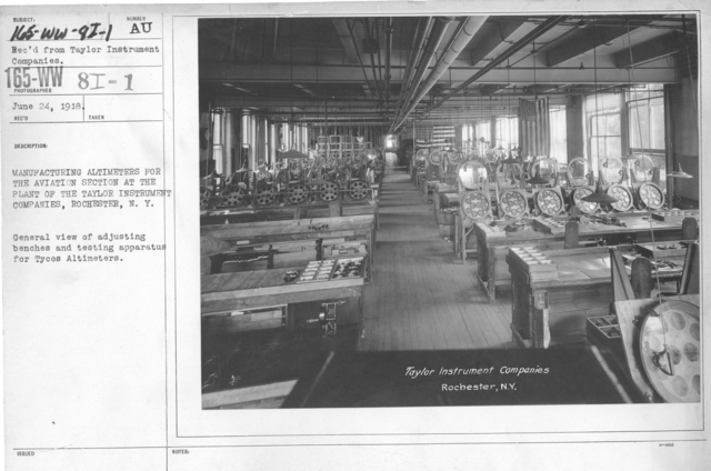 Airplanes - Instruments - Manufacturing altimeters for the aviation section at the plant of the Taylor Instrument Companies, Rochester, N.Y. General view of adjusting benches and testing apparatus for Tycos Altimeters