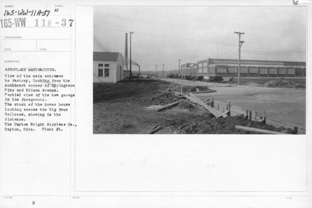 Airplanes - Manufacturing Plants - Airplane manufacture. View of the main entrance to Factory, looking from the southeast corner of Springboro Pike and Edison Avenue. Partial view of the new garage in the foreground. The steak of the power house looking across the Big Four Railroad, showing in the distance. The Dayton-Wright Airplane Co., Dayton, Ohio. Plant # 1