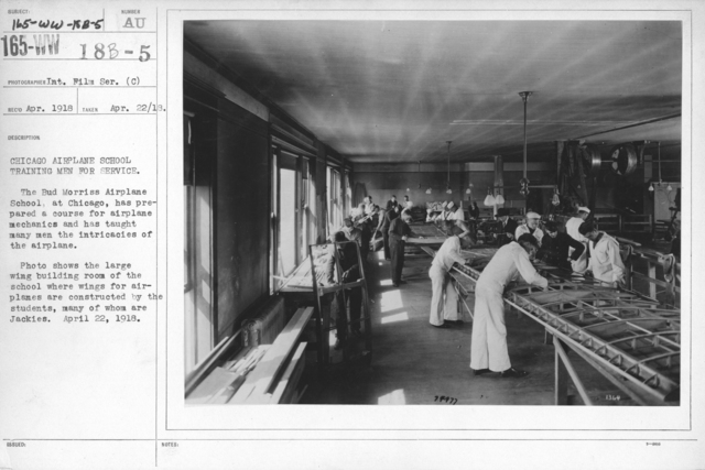 Airplanes - Miscellaneous - Chicago Airplane School Training Men for Service. The Bud Morris Airplane School at Chicago has prepared a course for airplane mechanics and has taught many men the intricacies of the airplane. Photo shows the large wing building room of the school where wings for airplanes are constructed by the students, many of whom are Jackies. April 22, 1918. Int. Film Ser