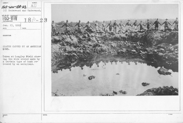 Airplanes - Miscellaneous - Crater caused by an American bomb. Taken at Langley Field showing the wide crater made by a certain type of bomb released by an aeroplane