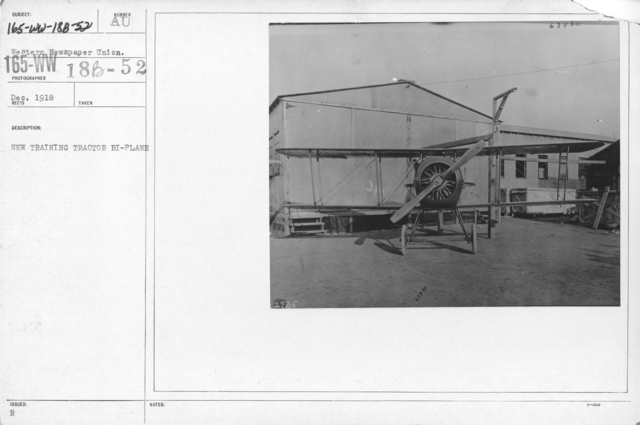 Airplanes - Miscellaneous - New training tractor Bi-Plane. Rear view of new defense advance training tractor bi-plane (Single seater) equipped with 100 h.p. 9 cylinder rotary gnome motor