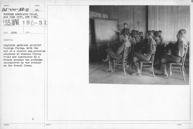 Airplanes - Miscellaneous - Teaching American Aviators foreign flying with the aid of a contour map, aviation students at Mineola flying field are instructed by a French aviator the problems encountered by the aviator on the French lines