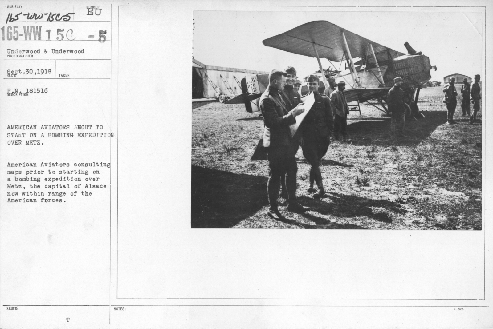 Airplanes - Operations - American Aviators about to start on a bombing expedition over Metz. American Aviators consulting maps prior to starting on a bombing expedition over Metz, the capital of Alsace now within range of the American forces