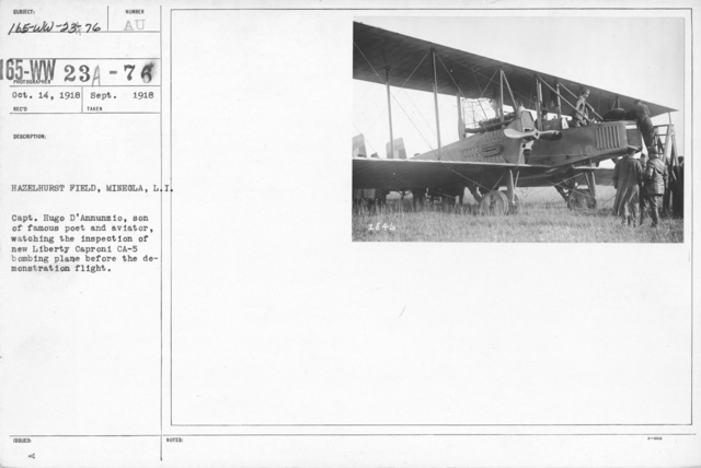 Airplanes - Types - Hazelhurst Field, Mineola, L.I. Capt. Hugo D'Annunzio, son of famous poet and aviator, watching the inspection of new Liberty Caproni CA-5 bombing plane before the demonstration flight