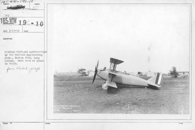 Airplanes - Types - Kirkham Triplane manufactured by the Curtiss Engineering Corp., Garden City, Long Island. Side view of plane in field