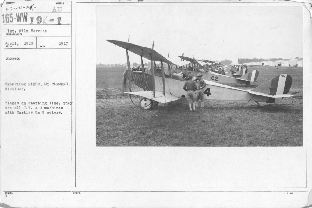 Airplanes - Types - Selfridge Field, Mt. Clemens, Michigan. Planes on starting line. They are all J.N. 4 A machines with Curtiss Ox 5 motors. Int. Film Service