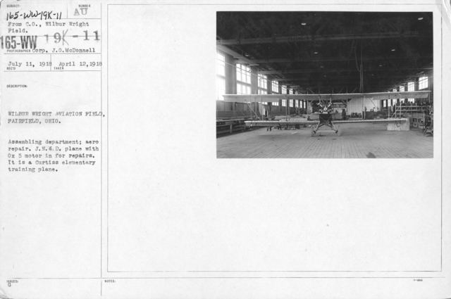 Airplanes - Types - Wilbur Wright Aviation Field, Fairfield, Ohio. Assembling department; aero repair. J.N.4.D. plane with Ox5 motor in for repairs. It is a Curtiss elementary training plane. From C.O., Wilbur Wright Field