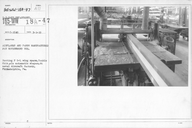 Airplanes - Wings - Airplanes and parts manufactured for government use. Routing F 5-L wing spars. Double skin ele automatic shaper. At Naval Aircraft Factory, Philadelphia, PA. U.S. Navy Department
