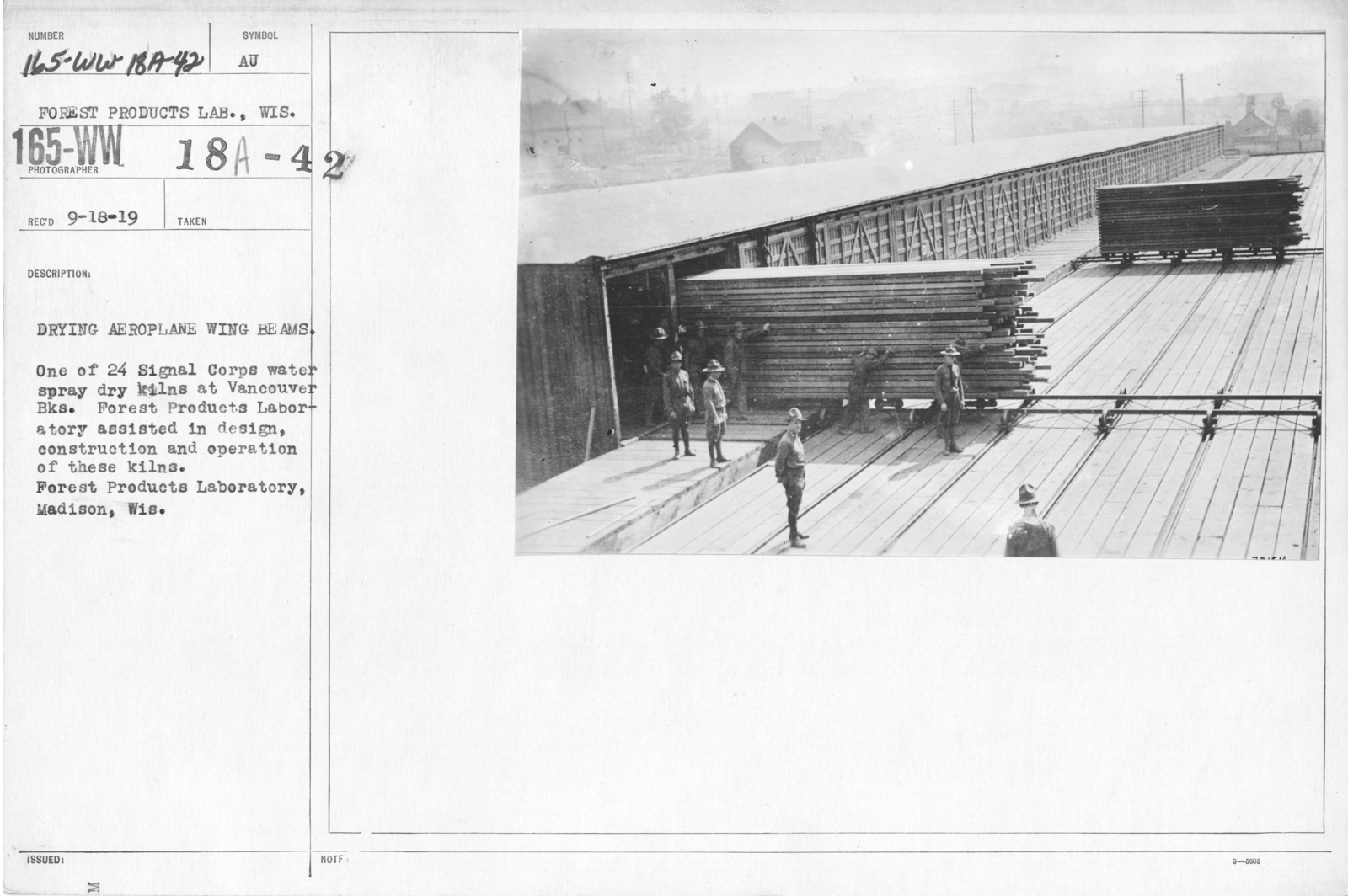 Airplanes - Wings - Drying aeroplane wing beams. One of 24 Signal Corps water spray dry kilns at Vancouver Bks. Forest Products Laboratory assisted in design, construction and operation of these kilns. Forest Products Laboratory, Madison, Wis