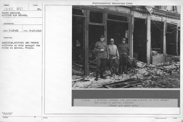 American, British and French soldiers on duty amongst the ruins at Amiens, France. 5-13-1918