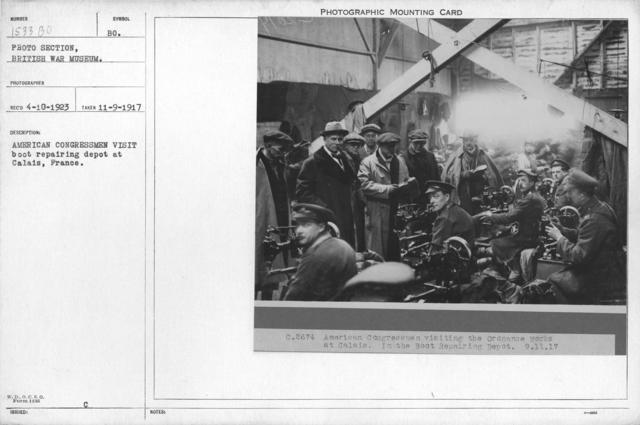 American congressmen visit boot repairing depot at Calais, France. 11-9-1917