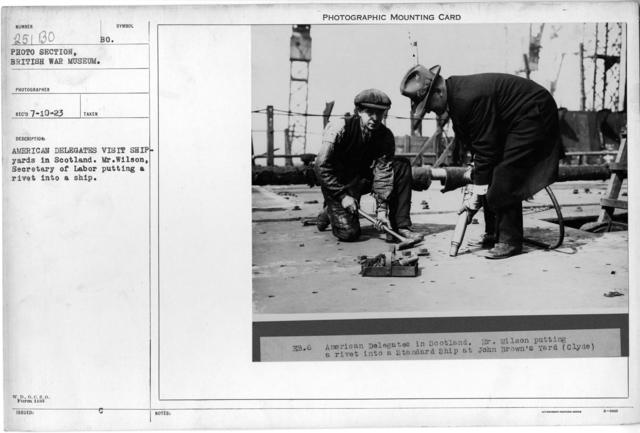 American delegates visit shipyards in Scotland. Mr. Wilson, Secretary of Labor putting a rivet into a ship