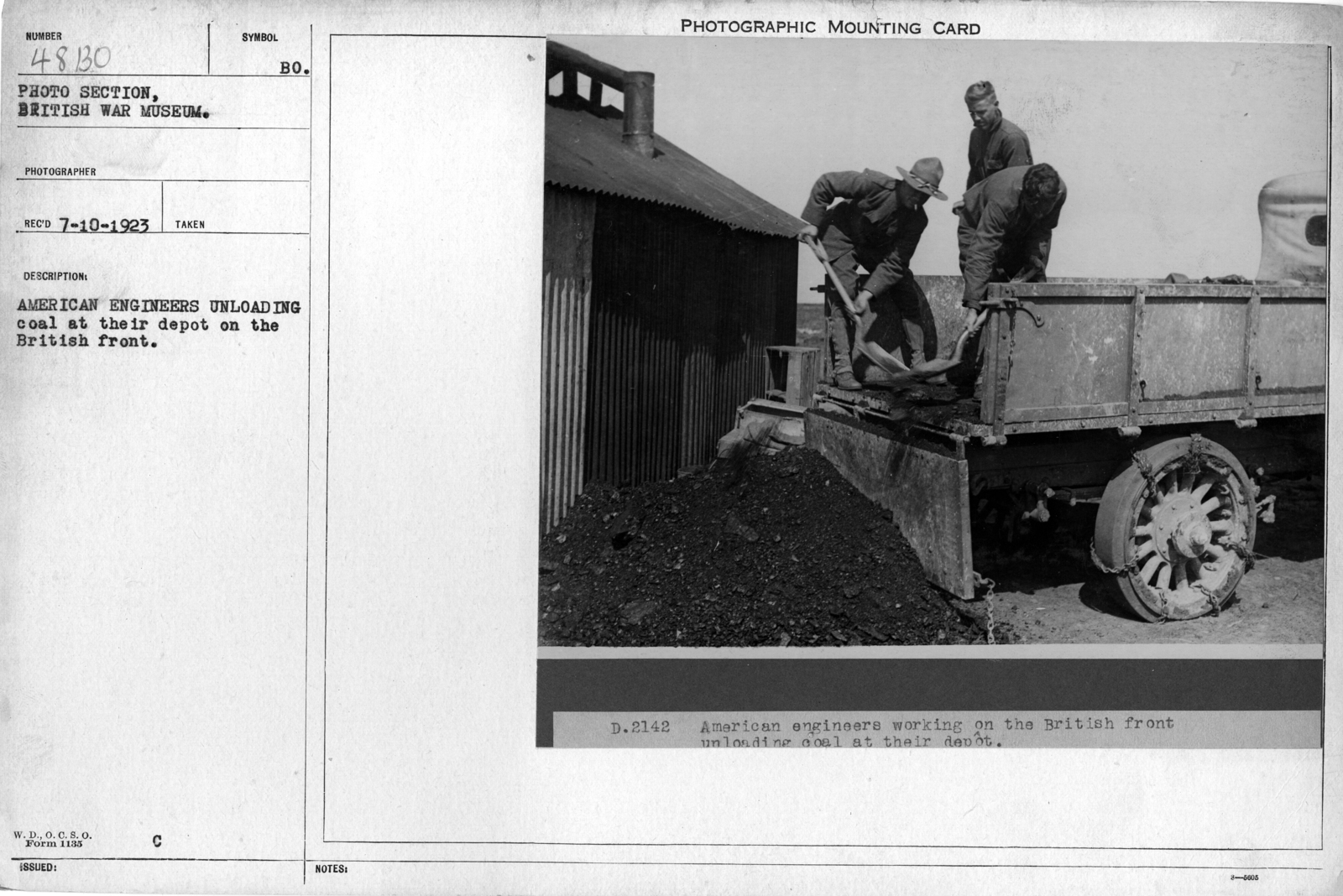 American Engineers unloading coal as their depot on the British front