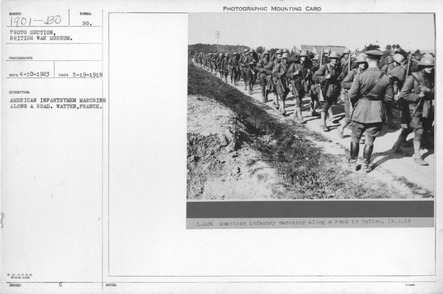 American infantrymen marching along a road. Watten, France