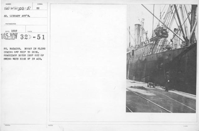 American Library Association - ALA - European - French - St. Nazaire. Books in sling coming off ship to dock. Sometimes boxes drop out of swing when high up in air