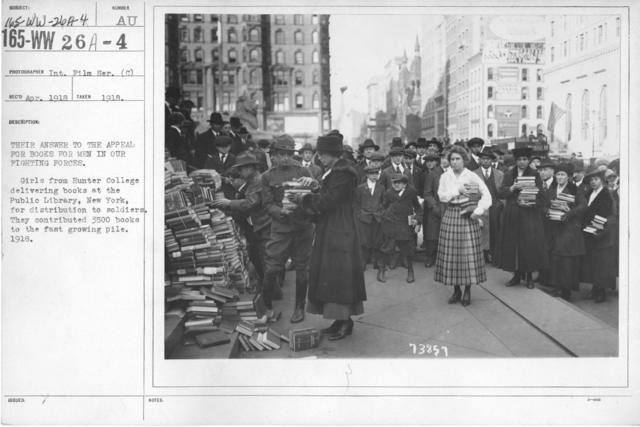 American Library Association - Campaigns - Their answer to the appeal for books for men in our fighting forces. Girls from Hunter College delivering books at the Public Library, New York, for distribution to soldiers. They contributed 3500 books to the fast growing pile. 1918. International Film Service