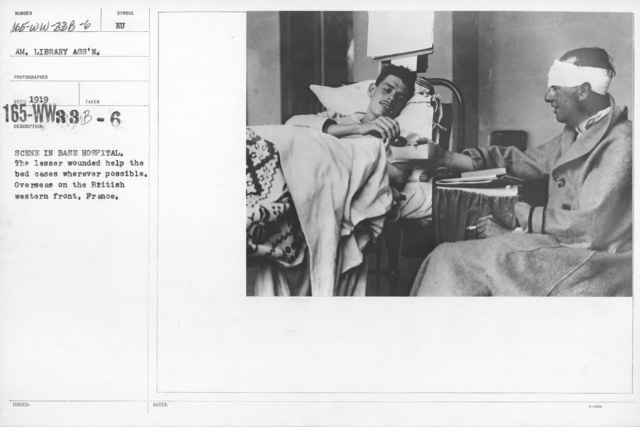 American Library Association - European - Hospitals - Scene in base hospital. The lesser wounded help the bed cases wherever possible. Overseas on the British western front, France