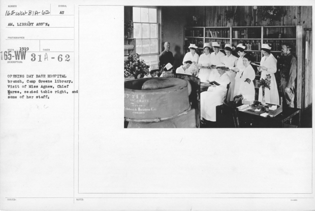 American Library Association - K thru N - Opening day base hospital branch, Camp Greene library. Visit of Miss Agnew, Chief Nurse, seated table right, and some of her staff