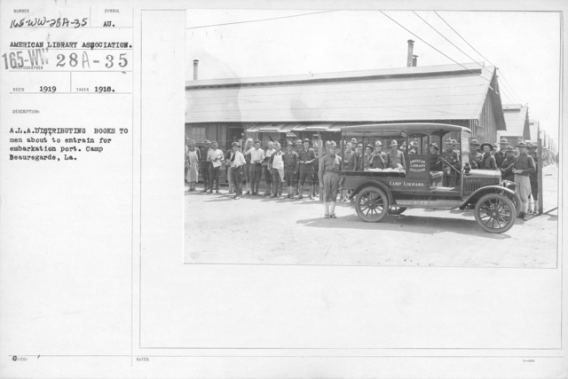 American Library Association - Libraries - Kansas through Mississippi - A.L.A. distributing books to men about to entrain for embarkation port. Camp Beauregard, LA