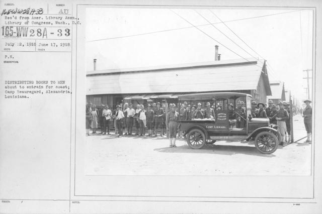 American Library Association - Libraries - Kansas through Mississippi - Distributing books to men about to entrain for coast; Camp Beauregard, Alexandria, Louisiana