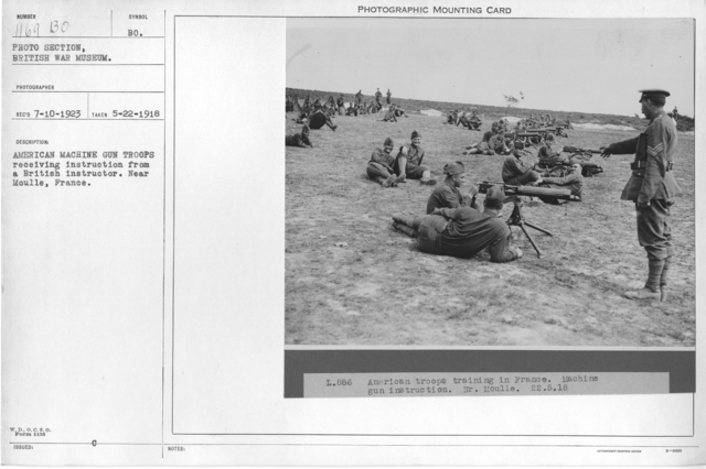 American machine guns troops receiving instruction from a British instructor. Near Moulle, France