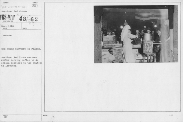 American Red Cross - Canteens - Red Cross canteens in France. Aemrican Red Cross canteen worker serving coffee to American soldiers in the canteen at Issoudum