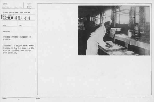 """American Red Cross - Canteens - United States Canteen in France. """"Thomas"""" a negro from Washington, D.C., is seen in the act of rolling out dough for cookies"""