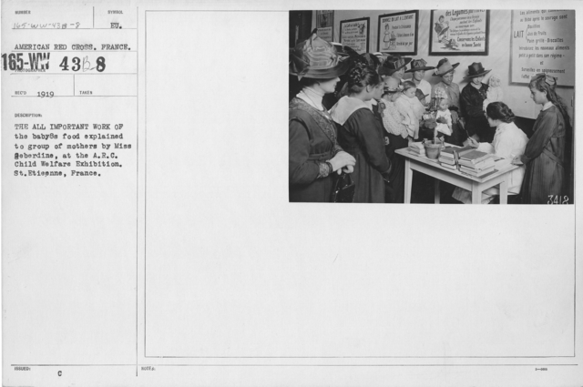 American Red Cross - Child Welfare Exhibition - The all important work of the baby's food explained to group of mothers by Miss Geberdine, at the A.R.C. Child Welfare Exhibition. St. Etieenne, France
