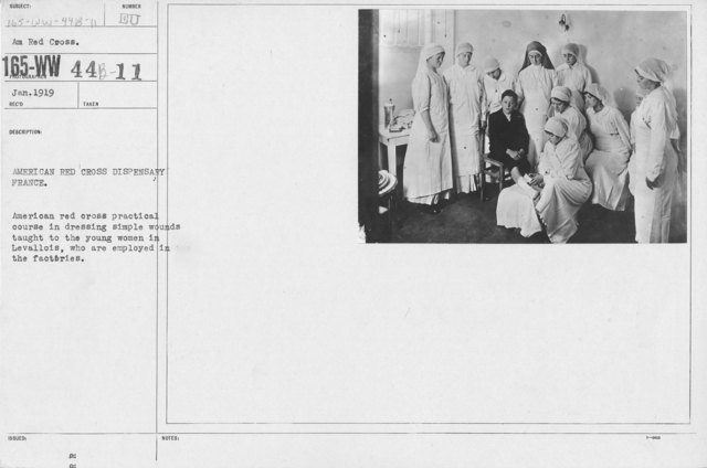 American Red Cross - Classes in Red Cross Work - France - American Red Cross Dispensary France. American Red Cross practical course in dressing simple wounds taught to the young women in Levallois, who are employed in the factories