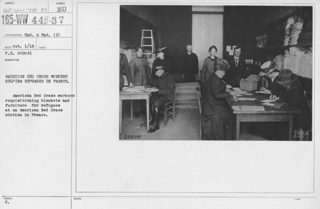 American Red Cross - Classes in Red Cross Work - France - American Red Cross Workers helping refugees in France. American Red Cross workers requisitioning blankets and furniture for refugees at an American Red Cross stationi n France