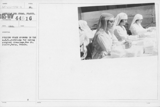 American Red Cross - Classes in Red Cross Work - France - Folding gauze sponges in the A.R.C. workrooms for making surgical dressing, Rue St. Didier, Paris, France