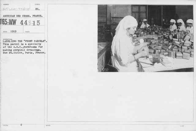 """American Red Cross - Classes in Red Cross Work - France - Labeling the """"Front Parcels."""" This parcel is a specialty of the A.R.C., workrooms for making surgical dressings. Rue St. Didier, Paris, France"""