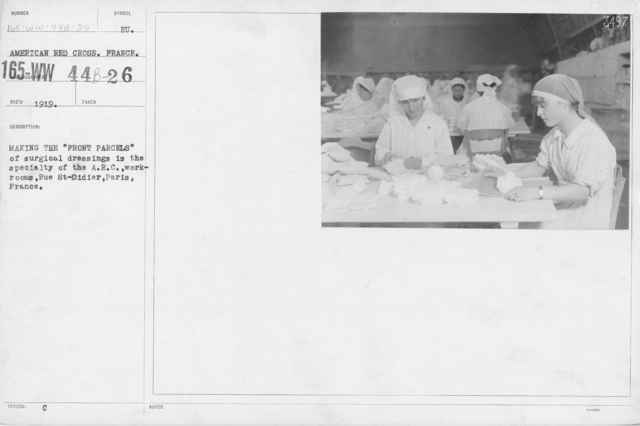 """American Red Cross - Classes in Red Cross Work - France - Making the """"front parcels"""" of surgical dressings is the specialty of the A.R.C. workrooms, Rue St. Didier, Paris, France"""