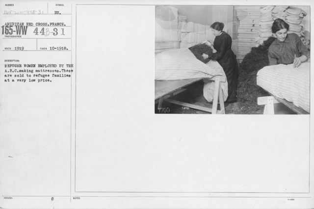 American Red Cross - Classes in Red Cross Work - France - Refugee women employed by the A.R.C. making mattresses. These are sold to refugee families at a very low price