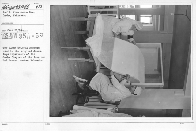 American Red Cross - Classes in Red Cross Work - New gauze-rolling machine used in the surgical dressings department of the Omaha Chapter of the American Red Cross. Omaha, Nebraska