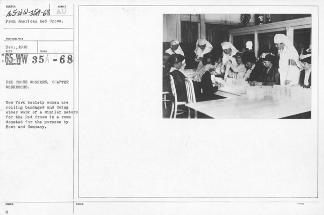 American Red Cross - Classes in Red Cross Work - Red Cross workers. Chapter workrooms. New York society women are rolling bandages and doing other work of a similar nature for the Red Cross in a room donated for the purpose by Best and Company