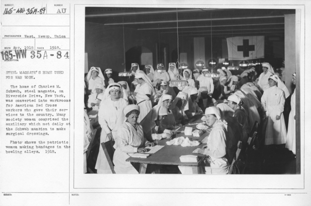 American Red Cross - Classes in Red Cross Work - Steel Magnate's home used for war work. The home of Charles M. Schwab, steel magnate, on Riverside Drive, New York, was converted into workrooms for American Red Cross workers who gave their services to the country. Many society women comprised the auxiliary which met daily at the Schwab mansion to make surgical dressings. Photo shows the patriotic women making bandages in the bowling alleys