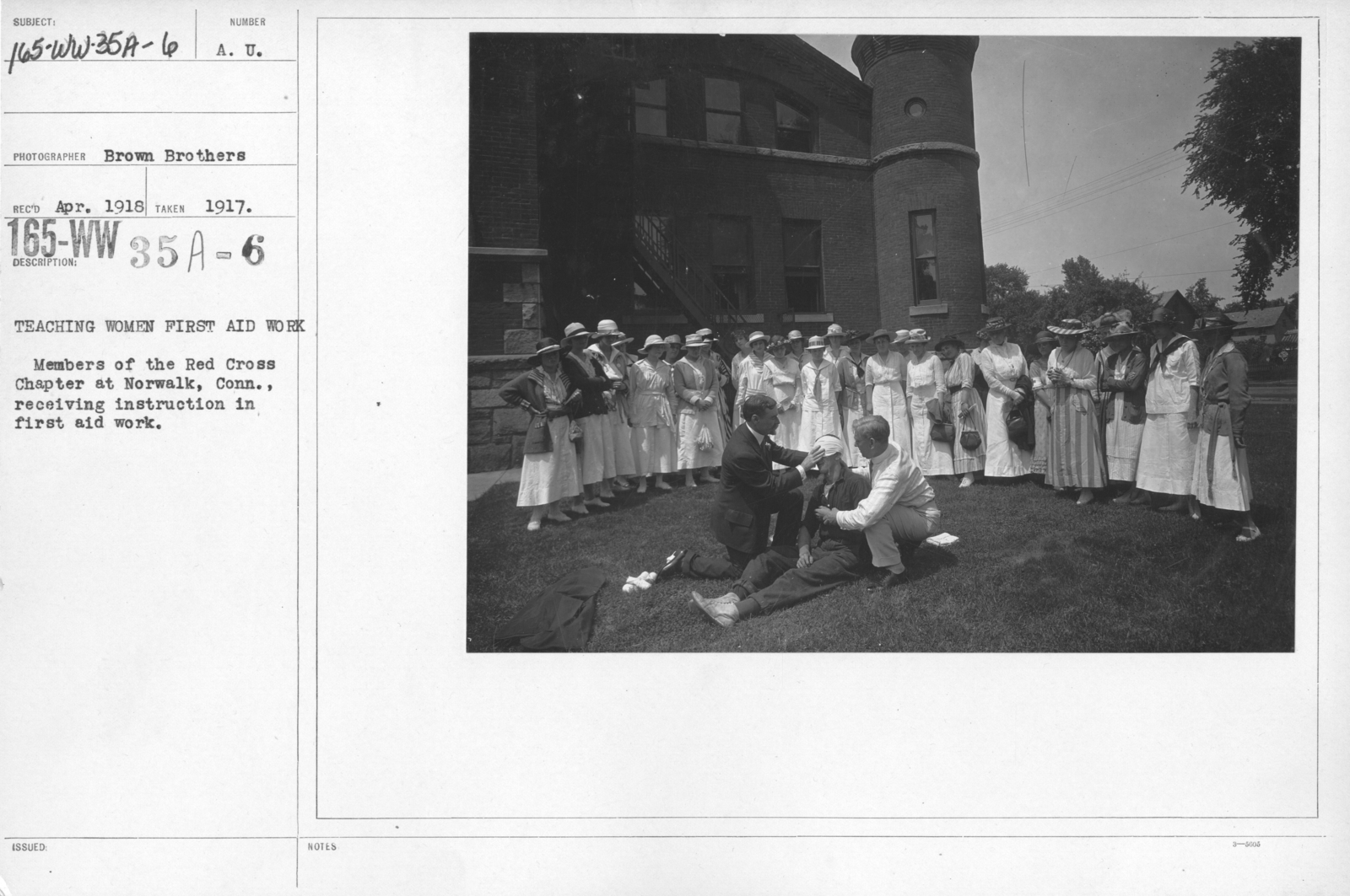 American Red Cross - Classes in Red Cross Work - Teaching women first aid work. Members of the Red Cross Chapter at Norwalk, Conn., receiving instruction in first aid work