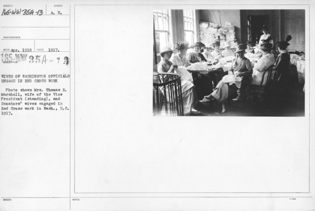 American Red Cross - Classes in Red Cross Work - Wives of Washington Officials engage in Red Cross Work. Photo shows Mrs. Thomas R. Marshall, wife of the Vice President (standing), and Senators' wives engaged in Red Cross work in Wash., D.C., 1917