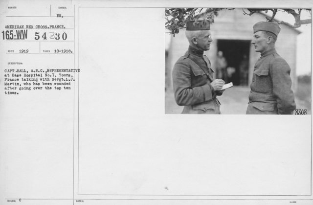 American Red Cross - E thru H - Capt. Hall, A.R.C., Representative at Base Hospital No. 7, Tours, France talking with Sergt. L.J. Martin, who has been wounded after going over the top ten times