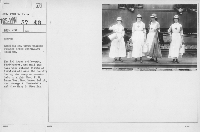 American Red Cross - Groups - American Red Cross Canteen workers serve travelling soldiers. The Red Cross coffee-pot, food-basket, and mail bag have been welcome sights at stations all over the country during the troop movements. Left to right: Mrs. E.W. Bonnaffon, Mrs. Mason Gulick, Mrs. George W. Vanderbilt, and Miss Mary L. Sheridan