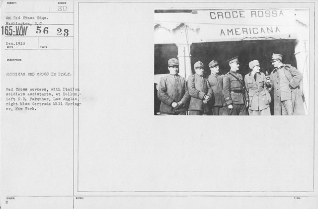 American Red Cross - Groups - American Red Cross in Italy. Red Cross workers, with Italian soldiers assistants, at Bellum, left R.D. Farquhar, Los Angeles, right Miss Gertrude Mill Springer, New York