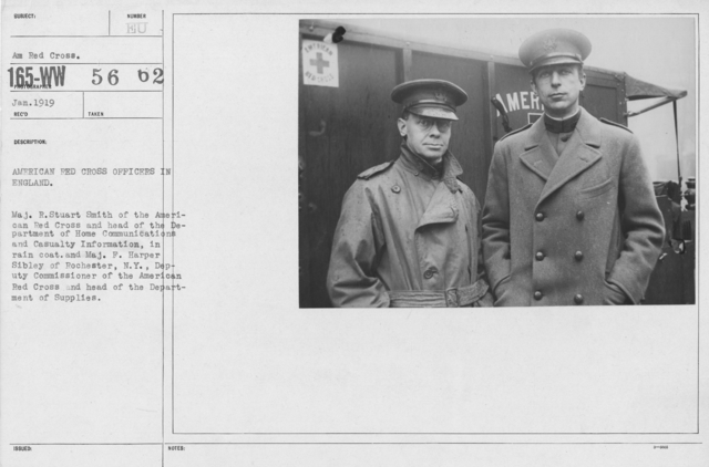 American Red Cross - Groups - American Red Cross Officers in England. Maj. R. Stuart Smith of the American Red Cross and head of the Department of Home Communciations and Casualty Information, in rain coat, and Maj. F. Harper Sibley of Rochester, N.Y., Deputy Commissioner of the American Red Cross and head of the Department of Supplies