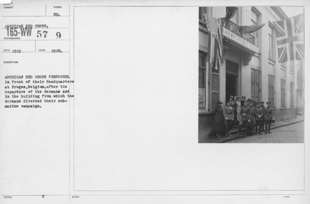 American Red Cross - Groups - American Red Cross Personnel in front of their Headquarters at Bruges, Belgium, after the departure of the Germans and in the building from which the Germans directed their submarine campaign