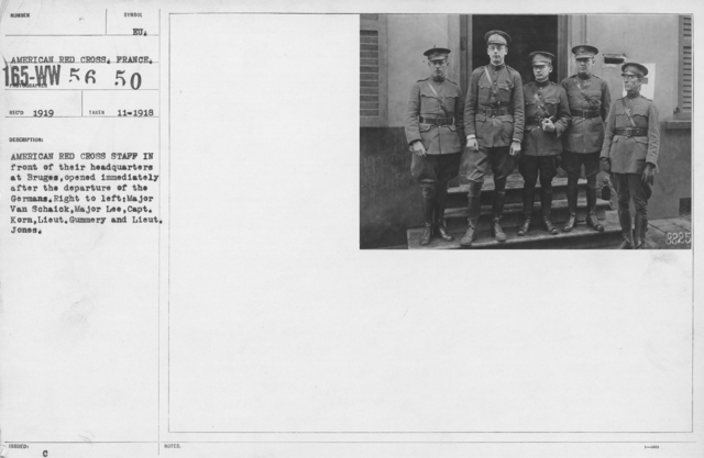 American Red Cross - Groups - American Red Cross Staff in front of their headquarters at Bruges, opened immediately after the departure of the Germans. Right to left: Major Van Schaick, Major Lee, Capt. Korn, Lieut. Gummery and Lieut. Jones