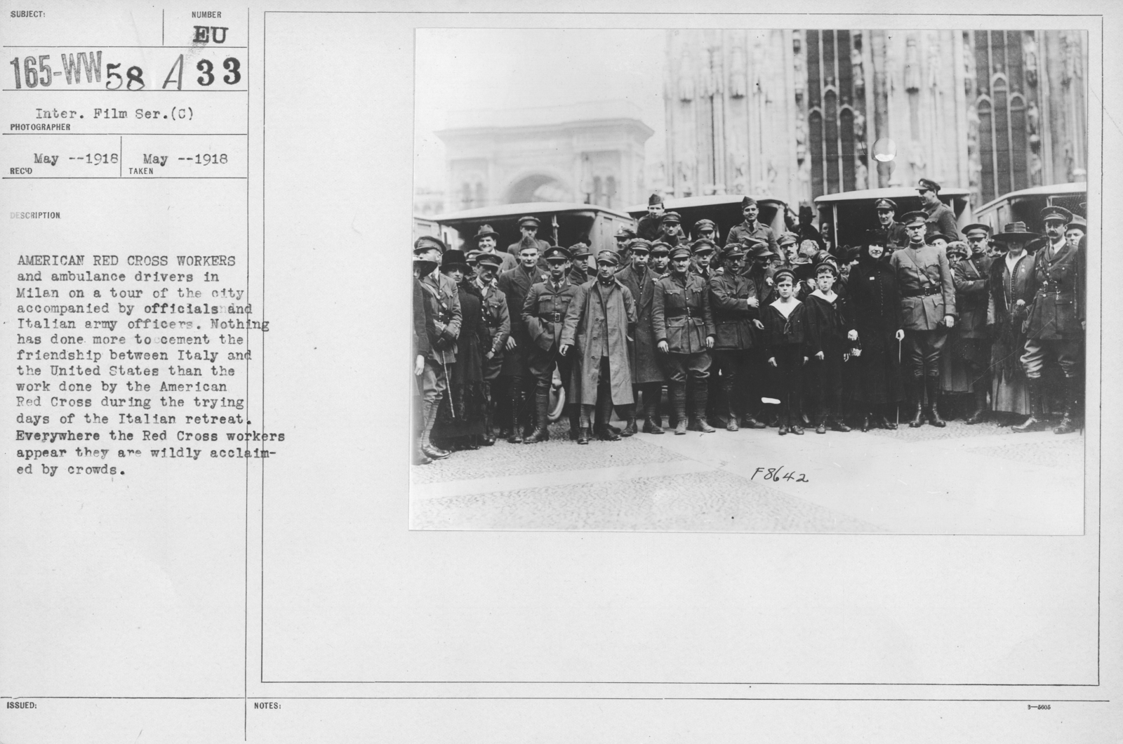 American Red Cross - Groups - American Red Cross workers and ambulance drivers in Milan on a tour of the city accomplanied by officials and Italian army officers. Nothing has done more to cement the friendship between Italy and the United States than the work done by the American Red Cross during the trying days of the Italian retreat. Everywhere the Red Cross workers appear they are are wildly acclaimed by crowds