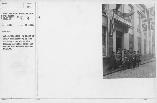 American Red Cross - Groups - A.R.C. Personnel in front of their headquarters in the building from which the Germans directed their submarine operations. Bruges, Belgium