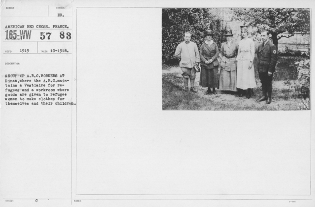 American Red Cross - Groups - Group of A.R.C. workers at Dinau, where the A.R.C. maintains a Vestiaire for refugees and a workroom where goods are given to refugee women to make clothes for themselves and their children